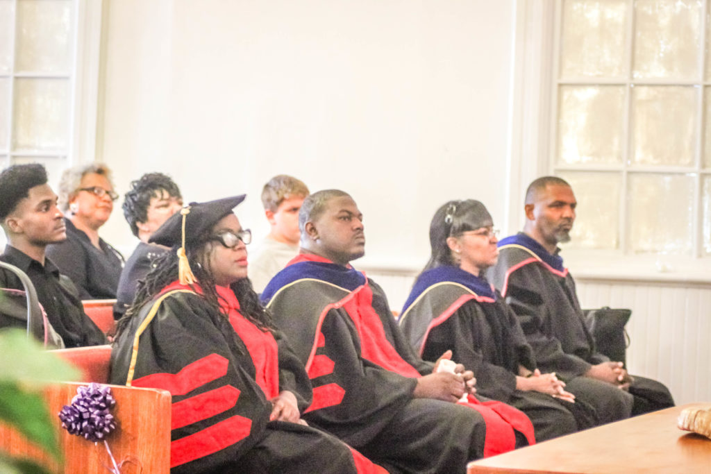 Bible College Graduates in Cap and Gowns
